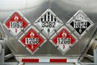 USDOT Hazardous Materials Transportation Placards on rear of a Fuel Tanker