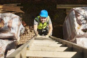 Worker climbing ladder