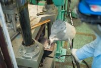 Operator pouring aluminum molten in to high precision casting mold