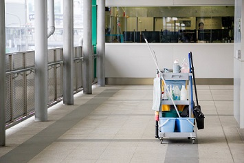 Cleaning equipment with cart on the floor in office building