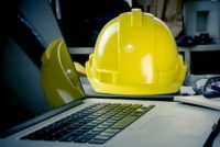 Hard hat and laptop, safety data