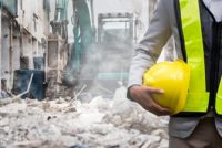 Safety professional at dusty construction site, possible silica exposure