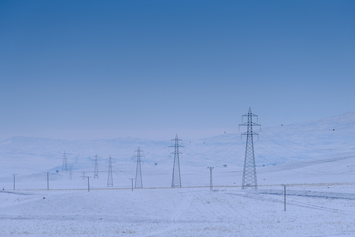 Power lines, electric grid in the cold of winter