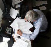Older worker at desk