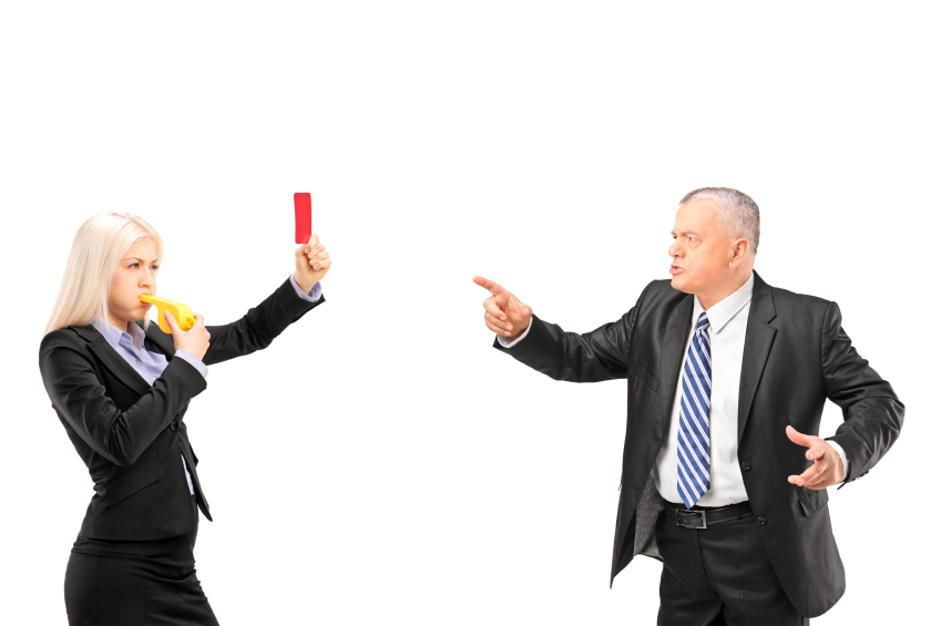 Professional woman showing a red card and blowing a whistle to h