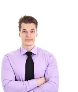 Young Businessman Looking At Empty Space Above Him, isolated