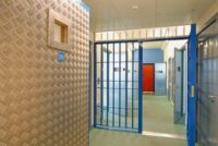 Interior view of a modern prison with open doors