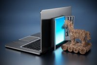 Trojan horse entering door on laptop computer