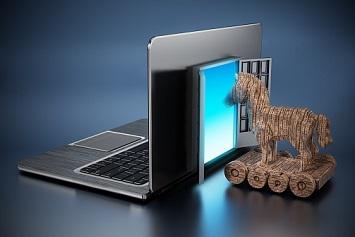 Trojan horse entering door on laptop computer
