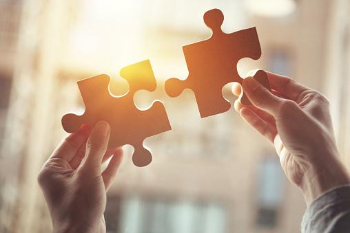 Puzzle Pieces Symbolizing Cooperation