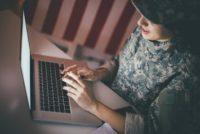 Female veteran using a laptop