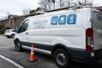 Charter Spectrum service van parked outside an apartment complex.