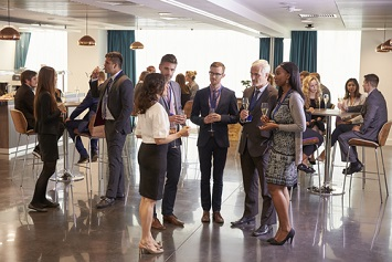 Delegates networking at event