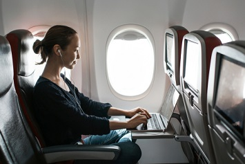 Woman working on plane