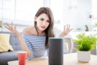 Woman frustrated with AI on smart speaker