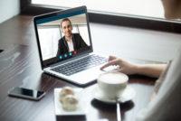 Remote worker having Skype meeting