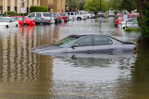 Cars in parking lot flooded during Hurricane Harvey
