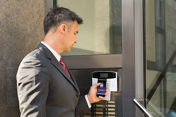 Man using smartphone for access controls