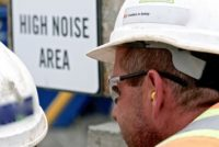 Construction Worker wearing personal protective hearing protection in a high noise area.