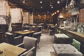 Interior of cozy restaurant. Contemporary design in loft style, modern dining place and bar counter, copy space