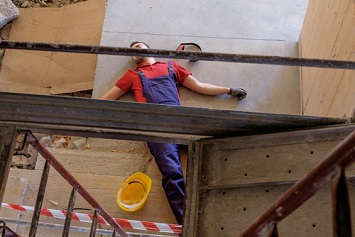 Worker on ground after falling from platform