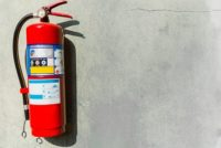 Fire extinguisher on concrete wall
