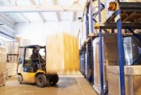 Gas powered forklift operating in a facility
