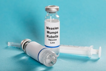 Measles vaccine vials and syringe
