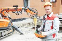 Worker using a demolition robot