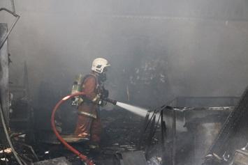 Firefighter putting out Class B warehouse fire
