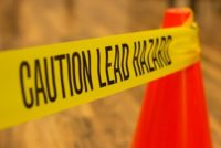 Caution tape warning of lead abatement hazard