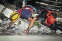 suspended platform workers cleaning windows in summer