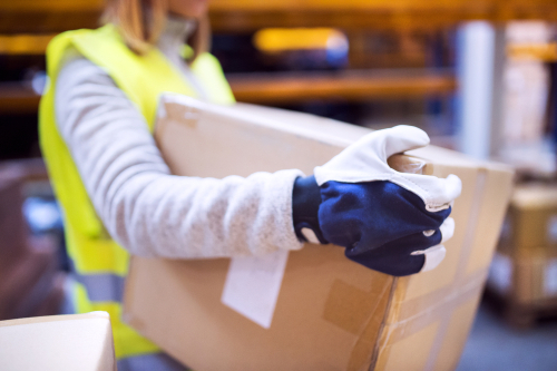 Warehouse worker properly carrying boxes